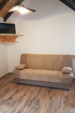 Postira, Obývacia izba v ubytovacej jednotke house, domáci miláčikovia povolení.