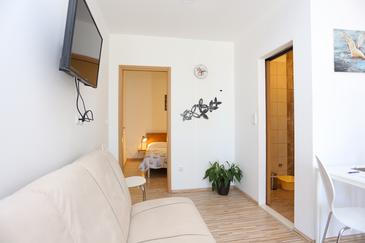 Podstrana, Obývacia izba v ubytovacej jednotke apartment, klimatizácia k dispozícii a WiFi.