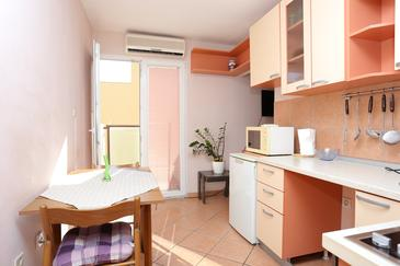 Split, Dining room in the studio-apartment, air condition available and WiFi.