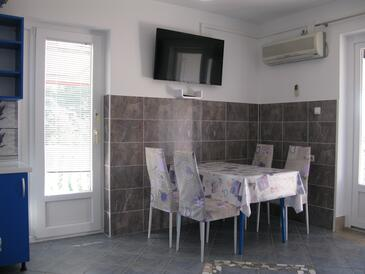 Lopar, Dining room in the apartment, air condition available and WiFi.