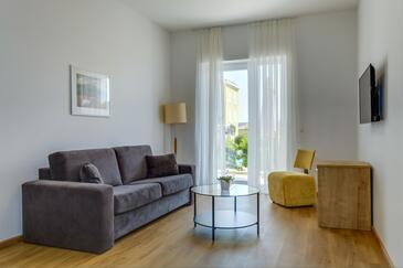Nerezine, Obývacia izba v ubytovacej jednotke room, klimatizácia k dispozícii, domáci miláčikovia povolení a WiFi.