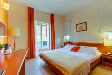 Nerezine, Ložnice v ubytování typu room, s klimatizací, domácí mazlíčci povoleni a WiFi.