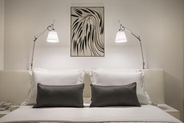 Novigrad, Dormitor în unitate de cazare tip room, aer condiționat disponibil şi WiFi.
