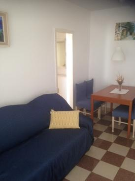 Brna, Living room in the apartment, air condition available, (pet friendly) and WiFi.