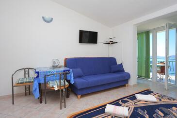 Marušići, Jedáleň v ubytovacej jednotke studio-apartment, domáci miláčikovia povolení a WiFi.