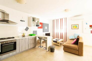 Sabunike, Living room in the apartment, air condition available and WiFi.