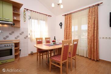 Jelsa, Jídelna v ubytování typu apartment, s klimatizací, domácí mazlíčci povoleni a WiFi.
