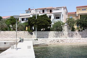 Barbat, Rab, Property 2015 - Apartments near sea with pebble beach.