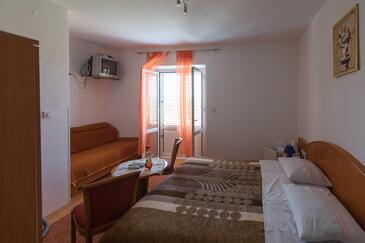Lopud, Ložnice v ubytování typu room, s klimatizací a WiFi.