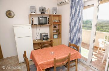 Povljana, Jídelna v ubytování typu apartment, s klimatizací a WiFi.