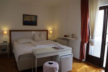 Lovran, Ložnice v ubytování typu room, s klimatizací a WiFi.