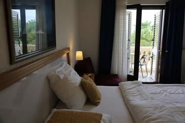 Lovran, Bedroom in the room, air condition available and WiFi.