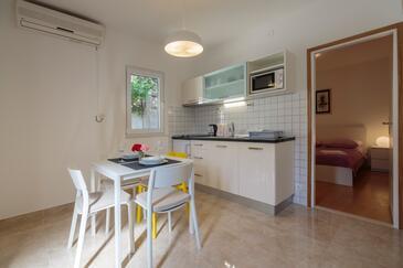 Komiža, Столовая в размещении типа apartment, доступный кондиционер и WiFi.