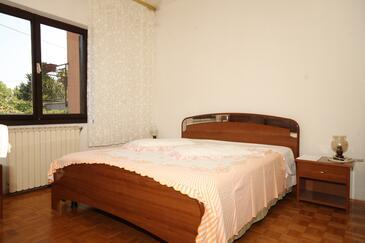 Umag, Ložnice v ubytování typu room.