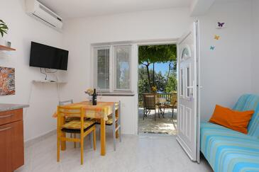 Lokva Rogoznica, Dining room in the apartment, air condition available, (pet friendly) and WiFi.