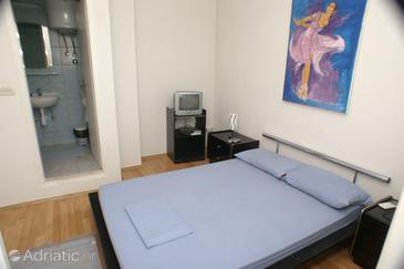 Splitska, Bedroom 1 in the room.