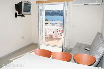 Stara Novalja, Living room in the apartment, dostupna klima i WIFI.