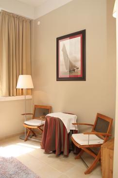 Orebić, Obývací pokoj v ubytování typu room.