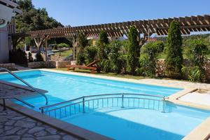 Family friendly apartments with a swimming pool Palit, Rab - 3210