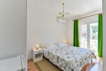 Tkon, Ložnice v ubytování typu room, s klimatizací a WiFi.