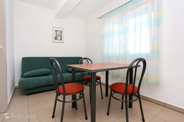 Lumbarda, Dining room in the apartment, dopusteni kucni ljubimci i WIFI.
