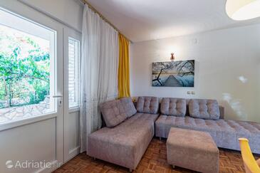 Jelsa, Sala de estar in the apartment, air condition available y WiFi.