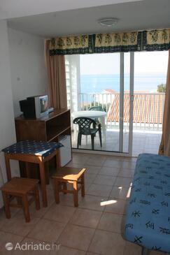 Jakišnica, Obývací pokoj v ubytování typu room, domácí mazlíčci povoleni a WiFi.