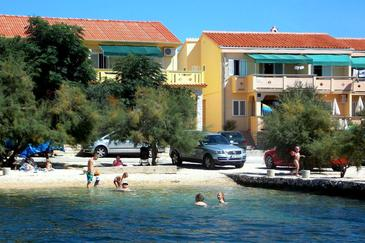 Kustići, Pag, Property 4088 - Apartments near sea with pebble beach.