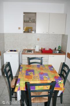 Stara Novalja, Dining room in the apartment.