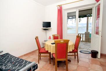 Lumbarda, Jídelna v ubytování typu apartment, domácí mazlíčci povoleni a WiFi.