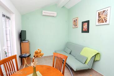Lumbarda, Гостиная в размещении типа apartment, доступный кондиционер, Домашние животные допускаются и WiFi.