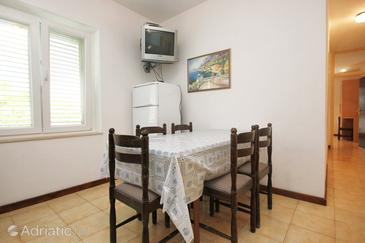 Lumbarda, Dining room in the apartment, air condition available, (pet friendly) and WiFi.