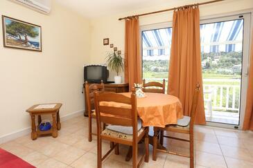Lumbarda, Jídelna v ubytování typu apartment, s klimatizací.