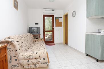 Lumbarda, Obývacia izba v ubytovacej jednotke apartment, dostupna klima, dopusteni kucni ljubimci i WIFI.