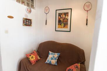 Grebaštica, Obývacia izba v ubytovacej jednotke apartment, domáci miláčikovia povolení a WiFi.