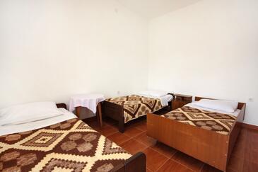 Pomena, Spálňa v ubytovacej jednotke room, klimatizácia k dispozícii a WiFi.