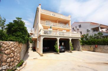 Barbat, Rab, Property 5002 - Apartments with pebble beach.
