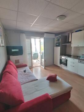 Lopar, Camera de zi în unitate de cazare tip apartment, aer condiționat disponibil şi WiFi.
