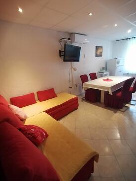 Lopar, Obývací pokoj v ubytování typu apartment, dostupna klima i WIFI.
