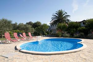Family friendly apartments with a swimming pool Mundanije, Rab - 5075