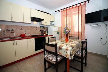 Tisno, Dining room in the apartment, (pet friendly) and WiFi.