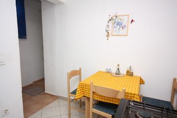 Maslinica, Blagovaonica u smještaju tipa studio-apartment, kućni ljubimci dozvoljeni i WiFi.