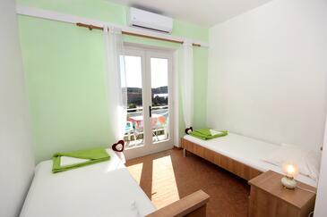 Cavtat, Ložnice v ubytování typu room, dostupna klima i WIFI.