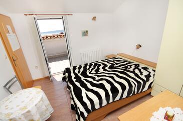 Krk, Spalnica v nastanitvi vrste room, dostopna klima in WiFi.