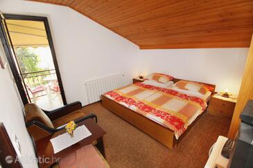 Malinska, Bedroom in the room.