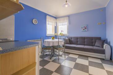 Selce, Blagovaonica u smještaju tipa apartment, dostupna klima i WiFi.