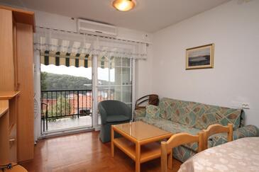 Jelsa, Dnevni boravak u smještaju tipa apartment, dostupna klima i WiFi.
