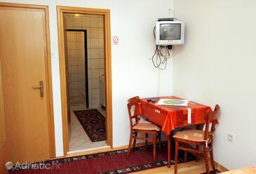 Krk, Dining room in the studio-apartment.