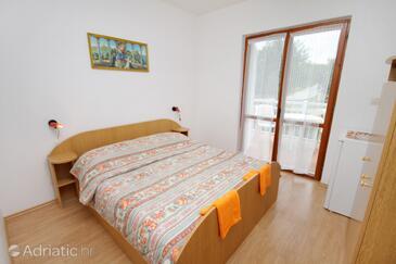 Njivice, Ložnice v ubytování typu room, s klimatizací, domácí mazlíčci povoleni a WiFi.