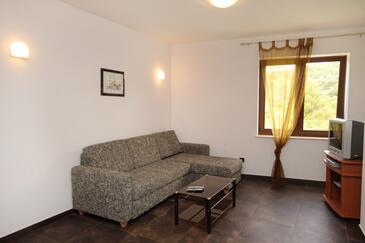 Vrbnik, Obývací pokoj v ubytování typu apartment, s klimatizací.